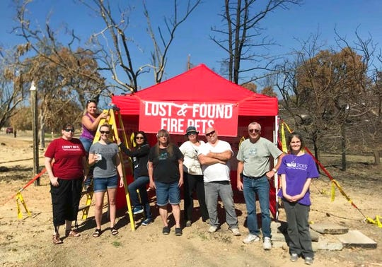 "In this undated photo, volunteers with Carr Fire Pet Rescue and Reunification pose with their ""Lost and Found Fire Pets"" kiosk in Redding. Volunteers continue to track and catch missing pets nearly two months after the fire was extinguished. They post pictures of the rescued pets in hopes that their owners will recognize them and reunite with them. More than 80 families who lost their homes in the deadly Carr Fire in July have learned weeks or months later that their dogs and cats had survived the deadly disaster."