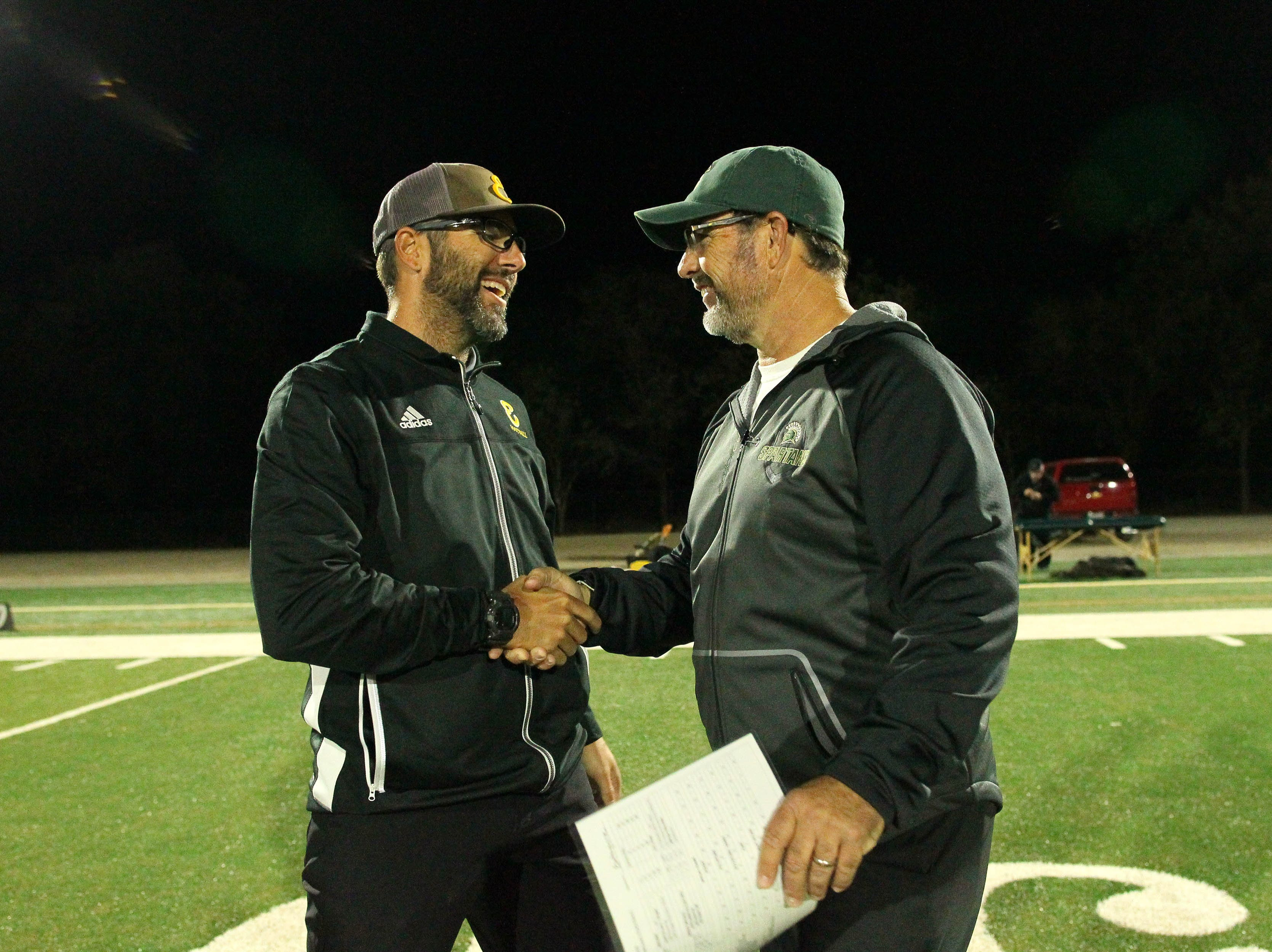 Enterprise Head Coach: Chris Combs, left, and Red Bluff Head Coach: Orlyn L. Culp II, greet each other before the game on Friday night in Red Bluff. 