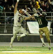 Red Bluff's Logan Robertson (11) tries to catch the ball against Enterprise's Anthony Norman (5) in the 2nd quarter. ///Prep Football - Enterprise @ Red Bluff, Friday 11/2/2018 in Red Bluff. The Spartans defeated the Hornets, 28 - 21 at home. /// (Photo by Hung T. Vu/Special to the Record Searchlight)