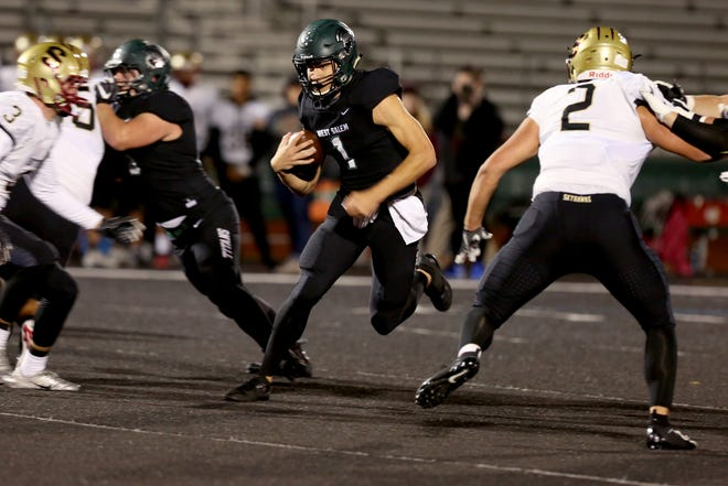 West Salem's Simon Thompson (1) finds a hole in the Southridge vs. West Salem football game in the first round of the OSAA Class 6A playoffs at West Salem High School on Friday, Nov. 2, 2018.