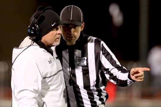 West Salem head coach Shawn Stanley talks with a referee in the Southridge vs. West Salem football game in the first round of the OSAA Class 6A playoffs at West Salem High School on Friday, Nov. 2, 2018.