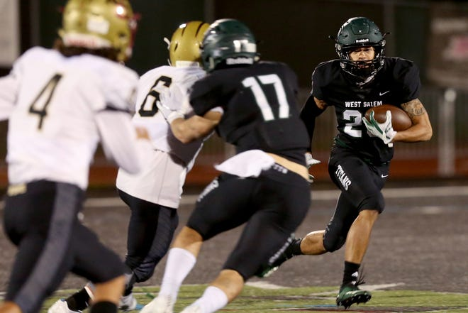 West Salem's Anthony Gould (23) rushes in the Southridge vs. West Salem football game in the first round of the OSAA Class 6A playoffs at West Salem High School on Friday, Nov. 2, 2018.