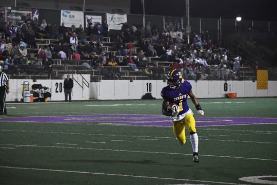 Salinas senior Poe Gaskins, shown here in the fall playing running back for the Cowboys, has been a star sprinter this spring.