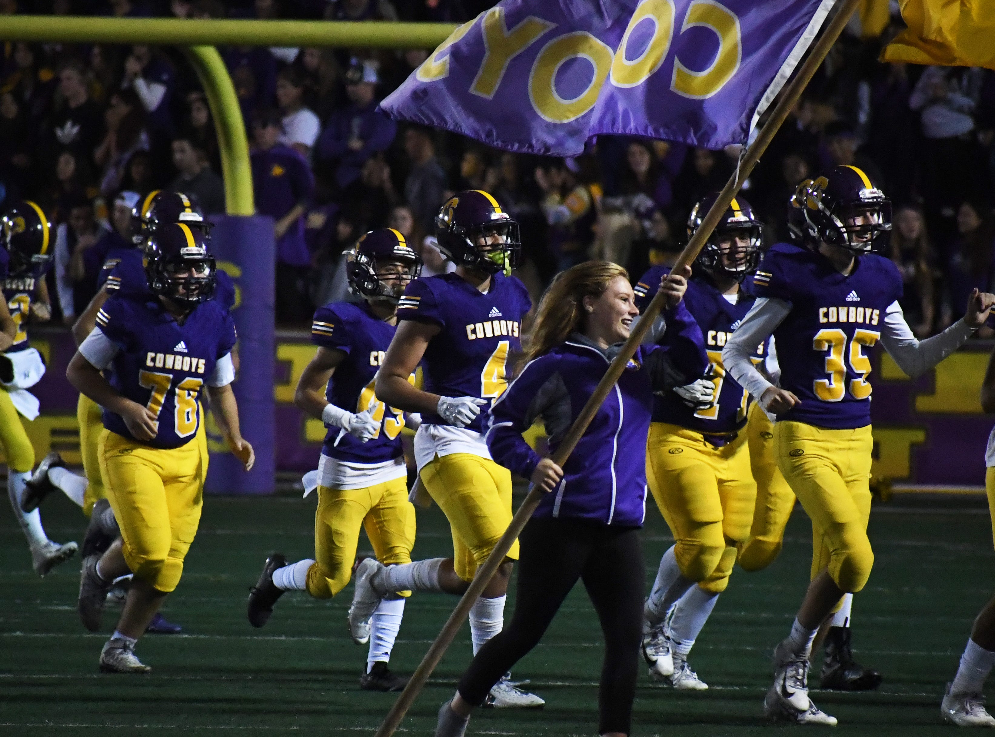 The Salinas Cowboys return to the field after halftime.