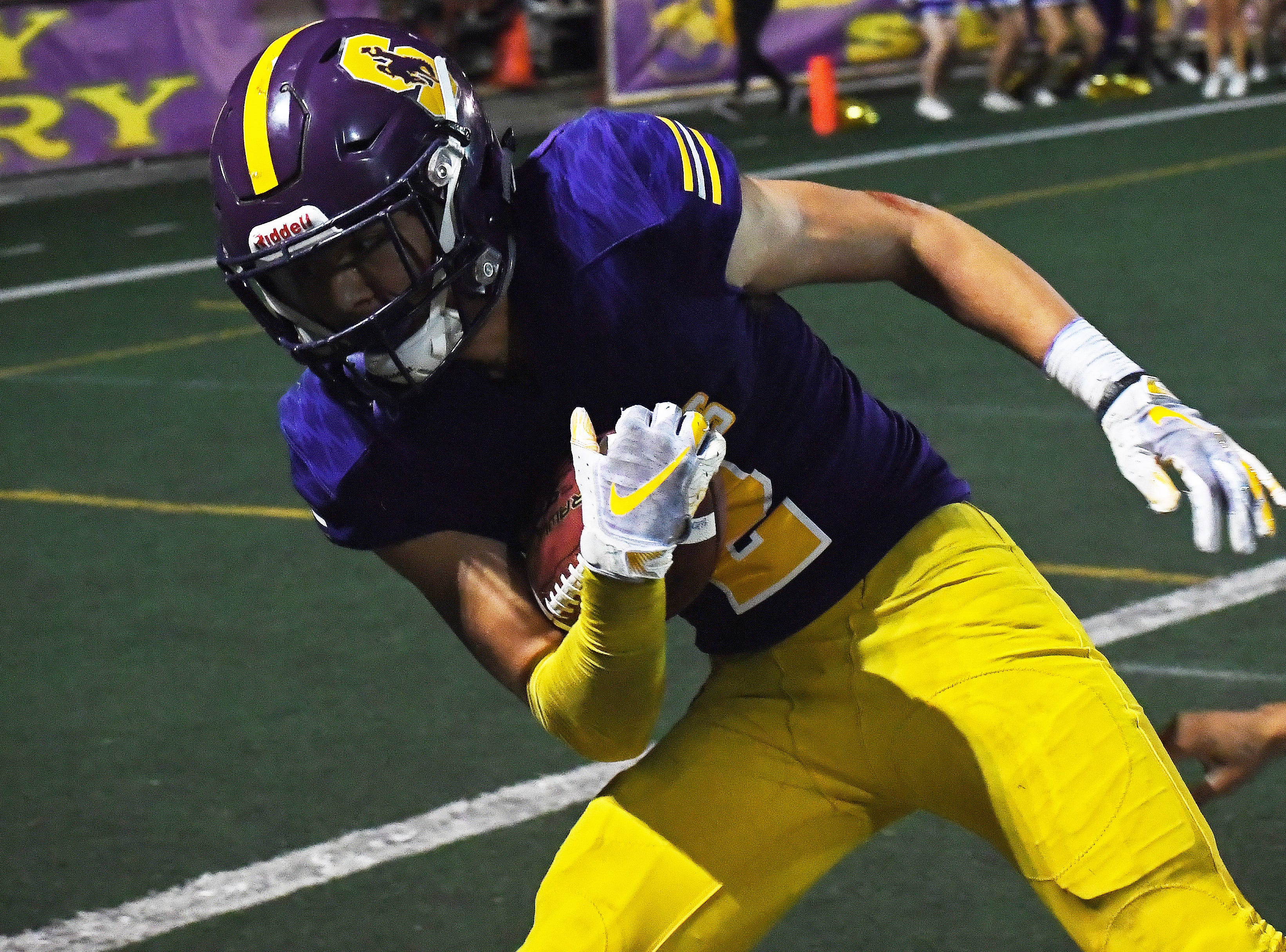 Salinas wide receiver Zachary Robison (2) gets pushed out of bounds.