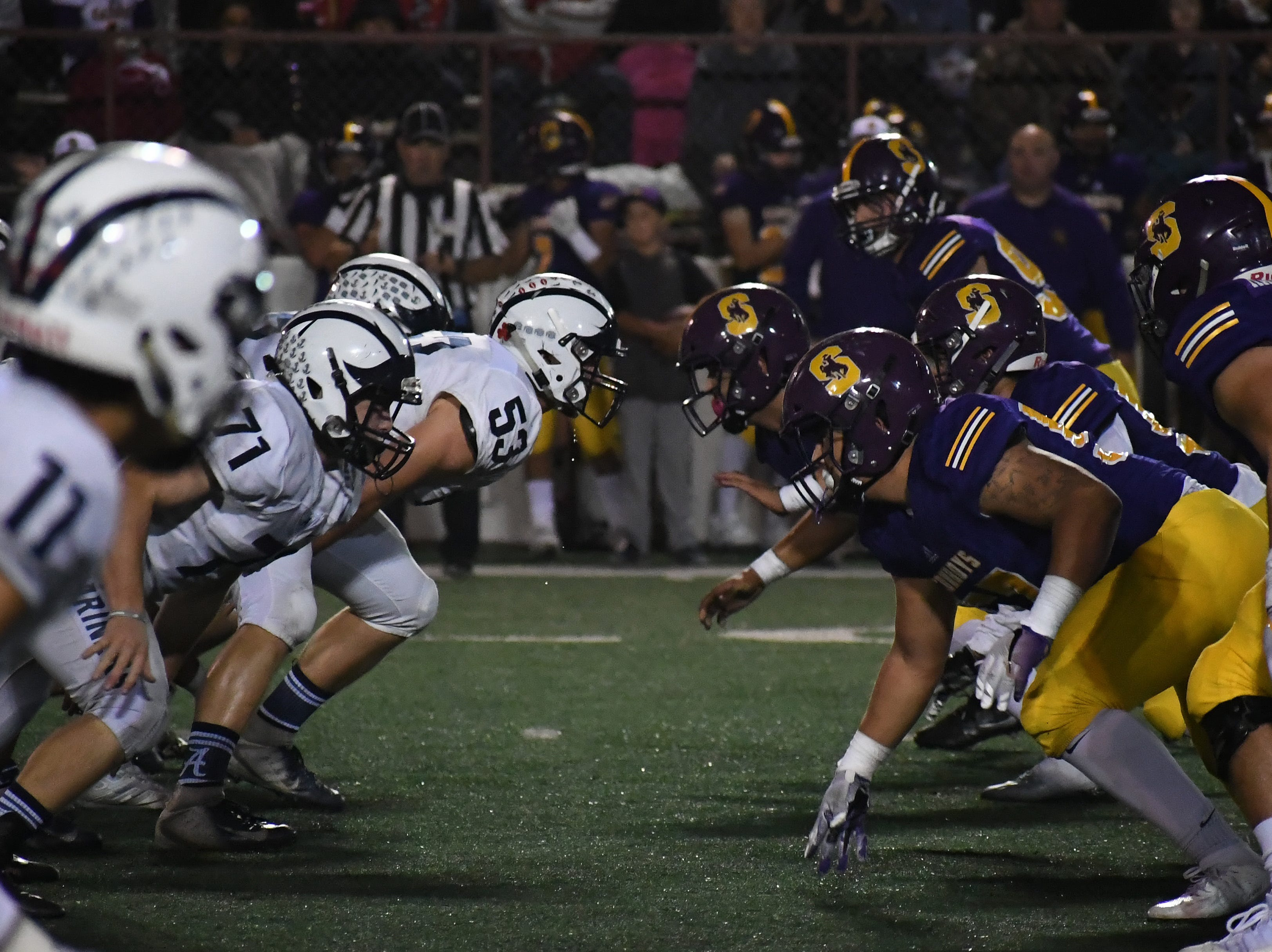 The Salinas defense fires off the line in the second quarter.