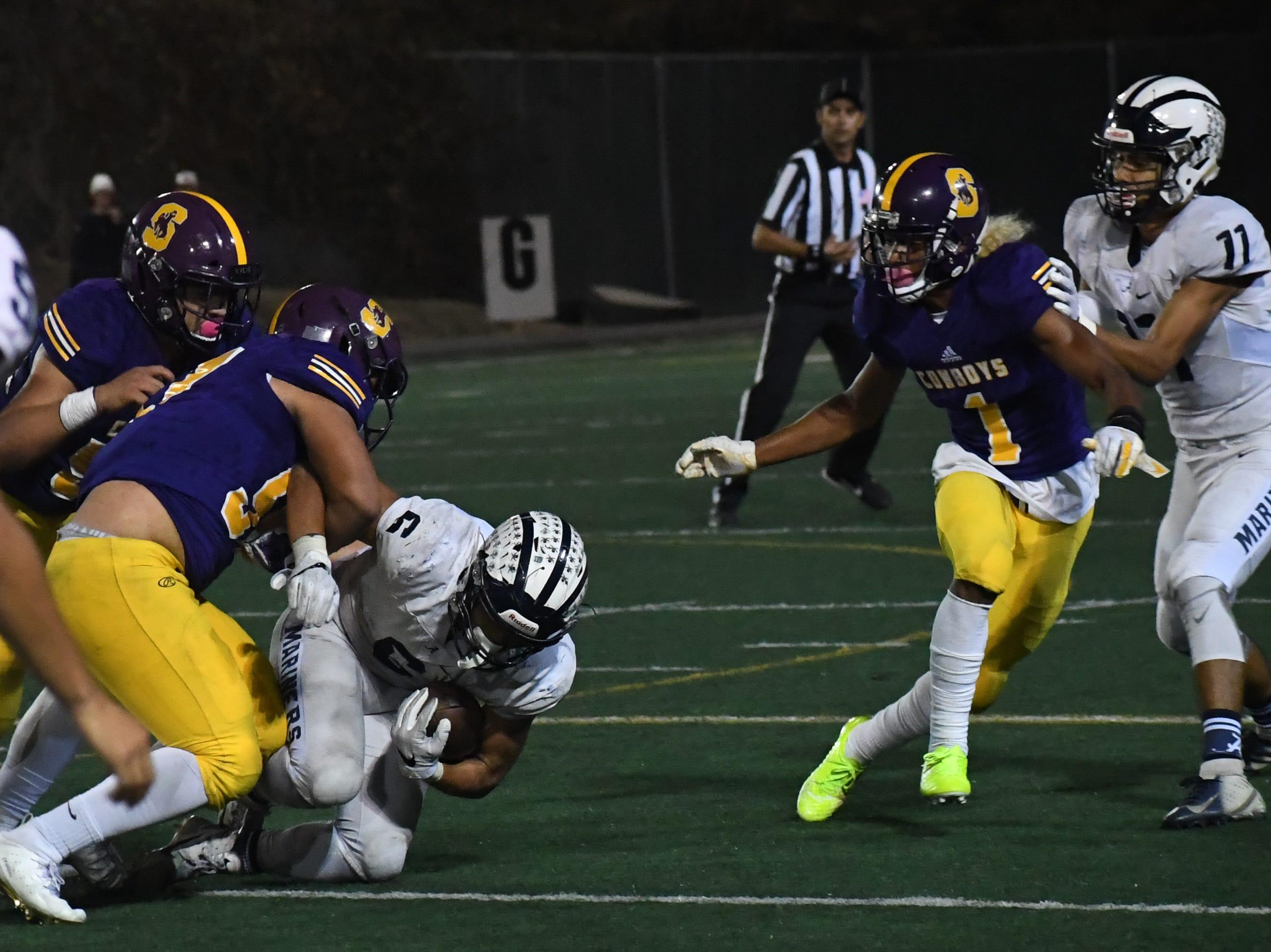 Salinas defensive lineman Sebastian Fomez (57) makes a tackle on an Aptos running back.