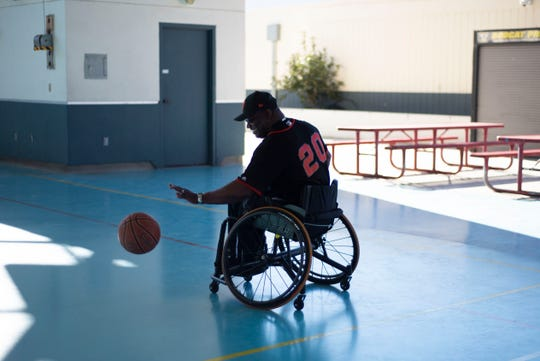 Kevin Patton teaches students at Buena Vista Middle School how to play chair basketball Nov. 2, 2018.