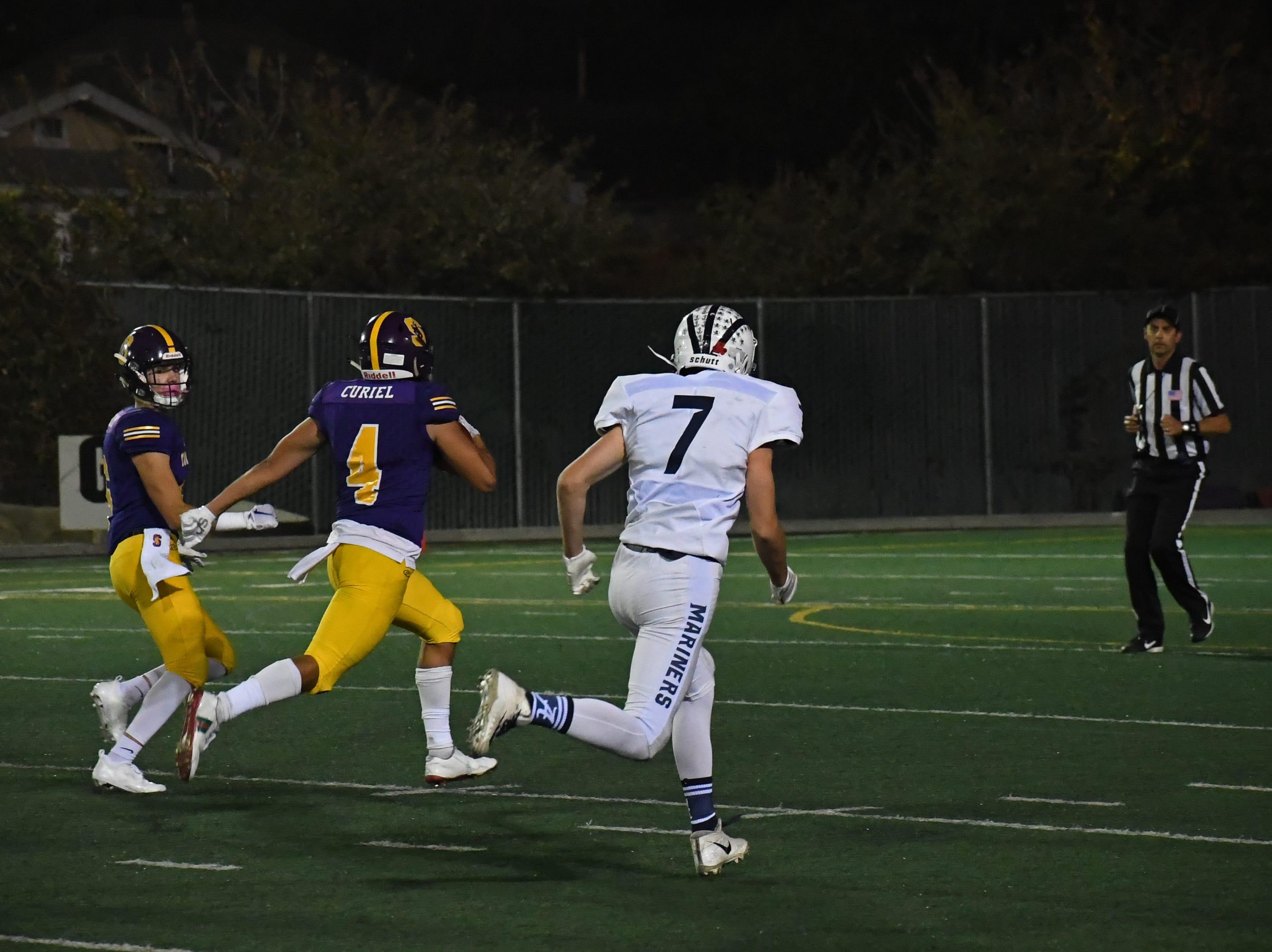 Salinas wide receiver Ivan Curiel (4) sprints past the defense for a touchdown.