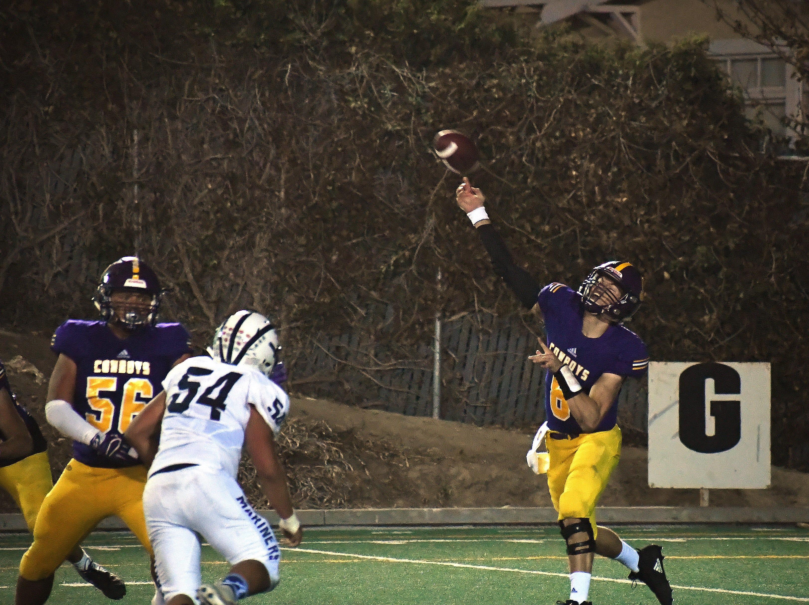 Salinas quarterback Carl Richardson (8) throws the ball downfield.