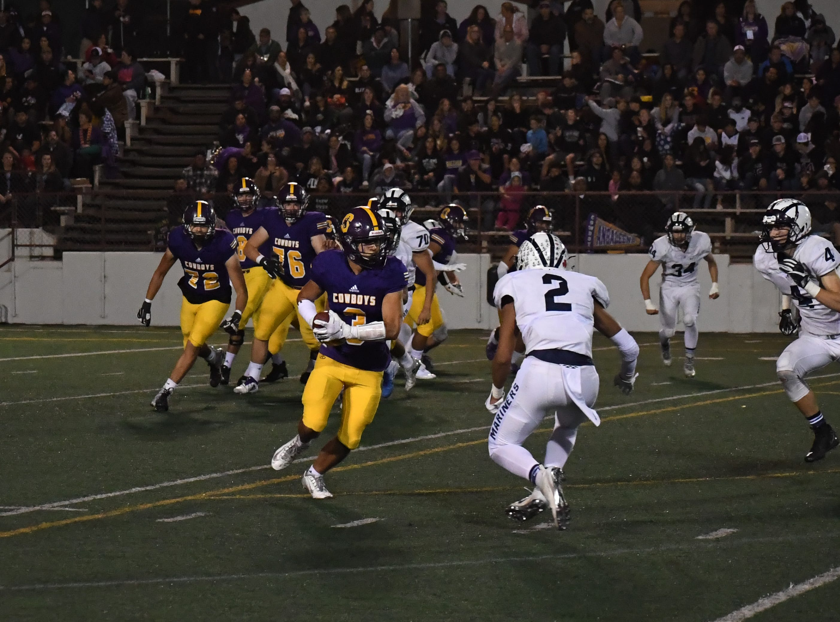 Salinas wide receiver John Mendalla (3) catches a screen pass and looks upfield.