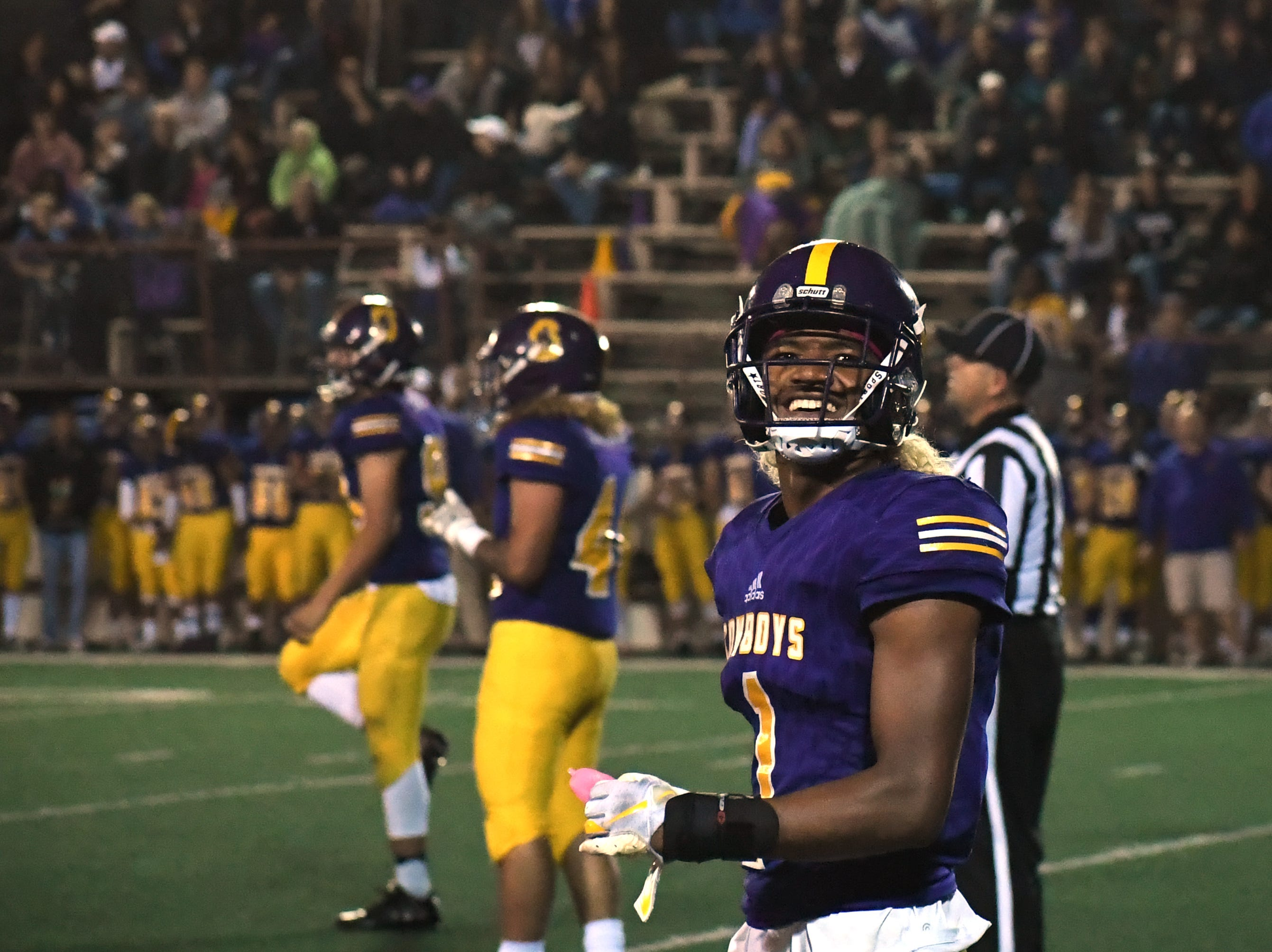 Salinas cornerback Poe Gaskins Jr. (1) laughs with a friend in the crowd.