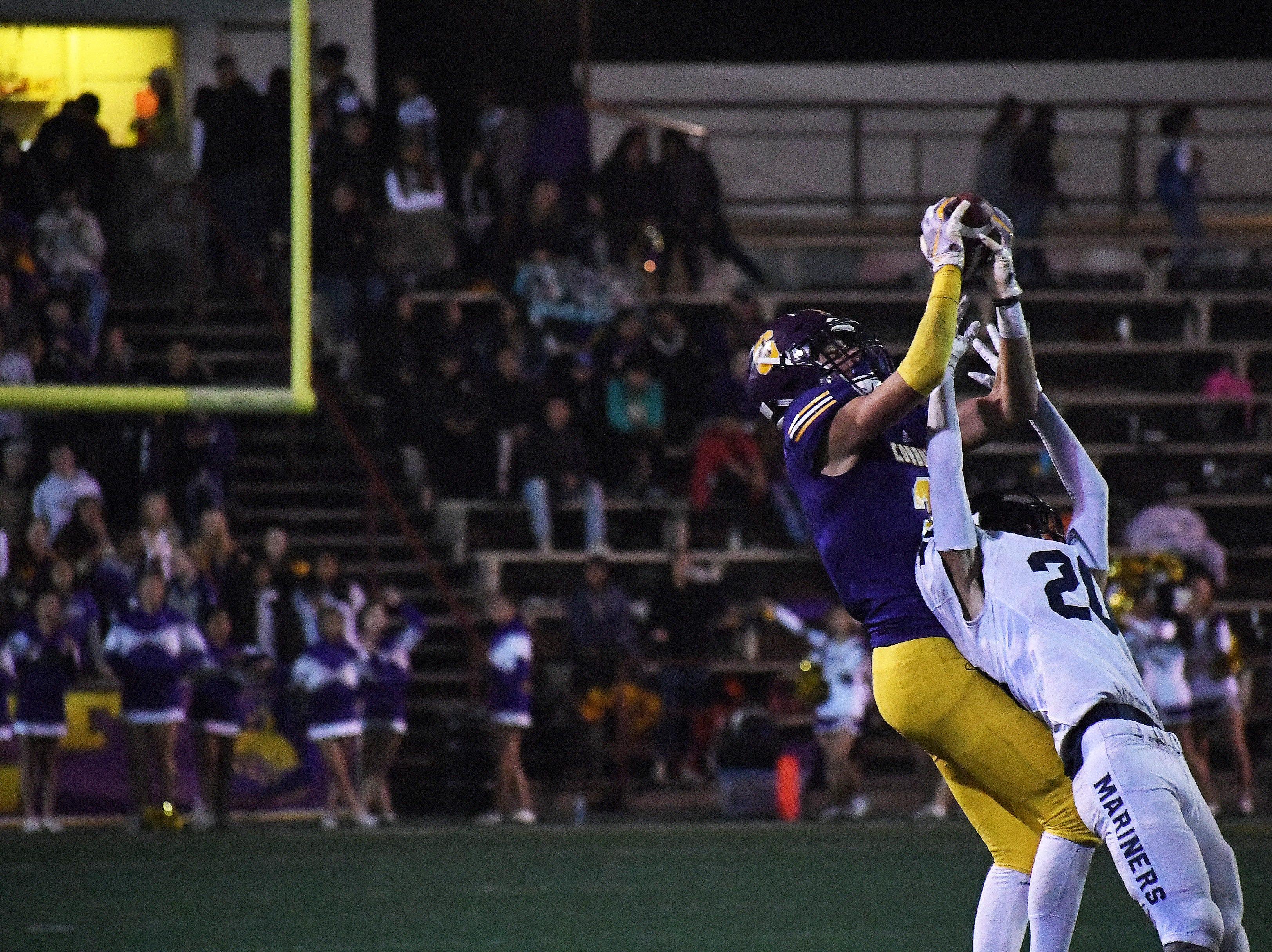 Salinas wide receiver Zachary Robison (2) makes a catch over an Aptos defender.