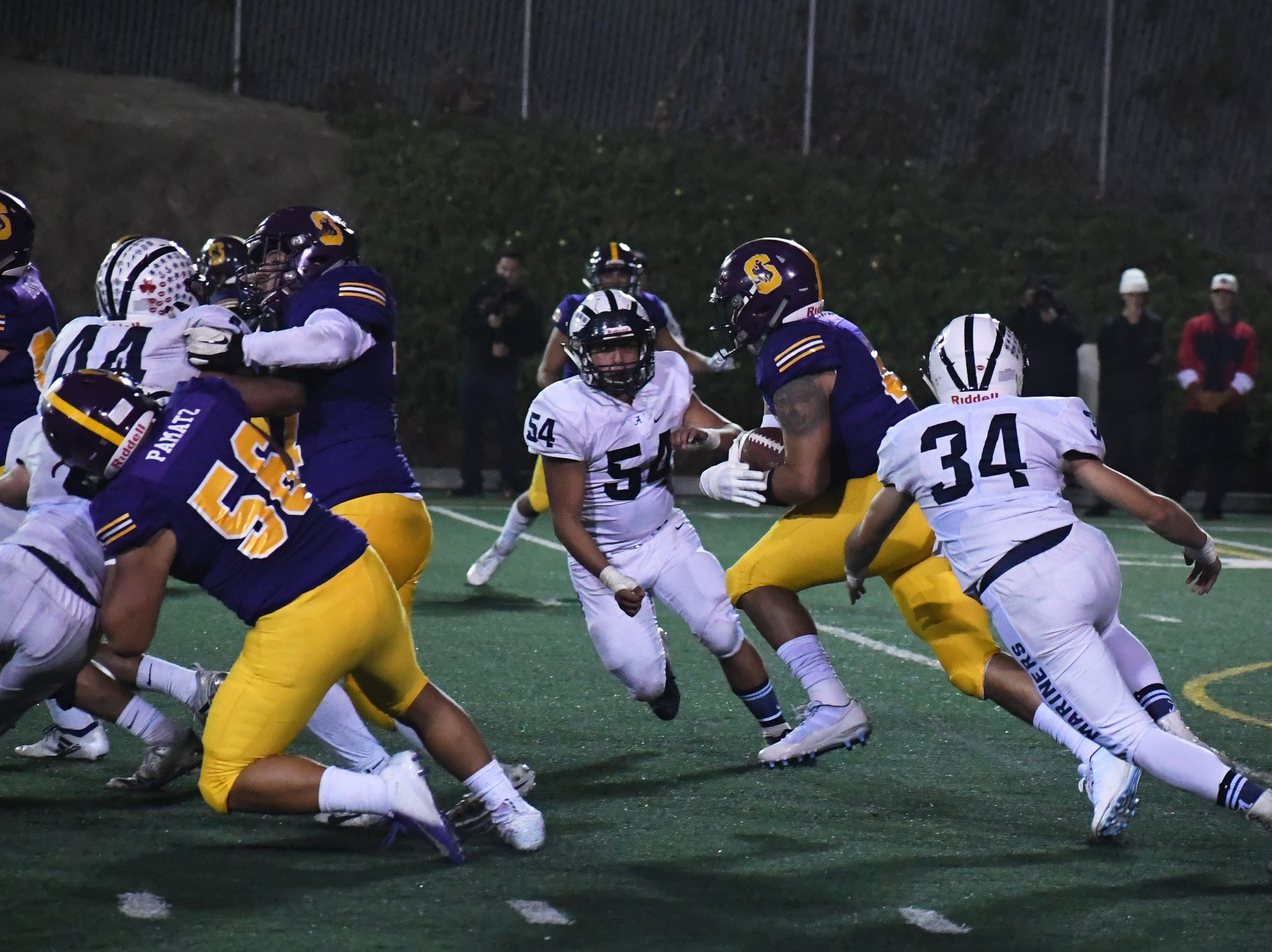 Salinas running back Mike Cortez (41) runs up the middle in the second half.