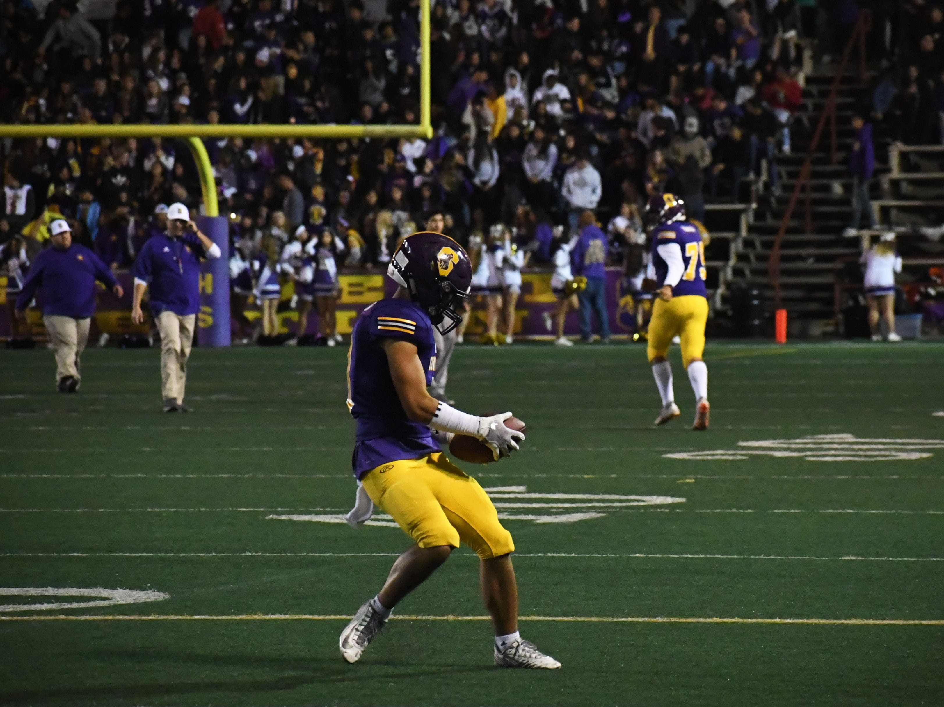 Salinas wide receiver Chad Fellom (6) catches a pass during halftime.
