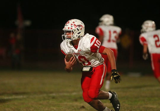Christoval's Brayden Wilcox (10) makes a play downfield Friday, Nov. 2, 2018, during their game against Miles.