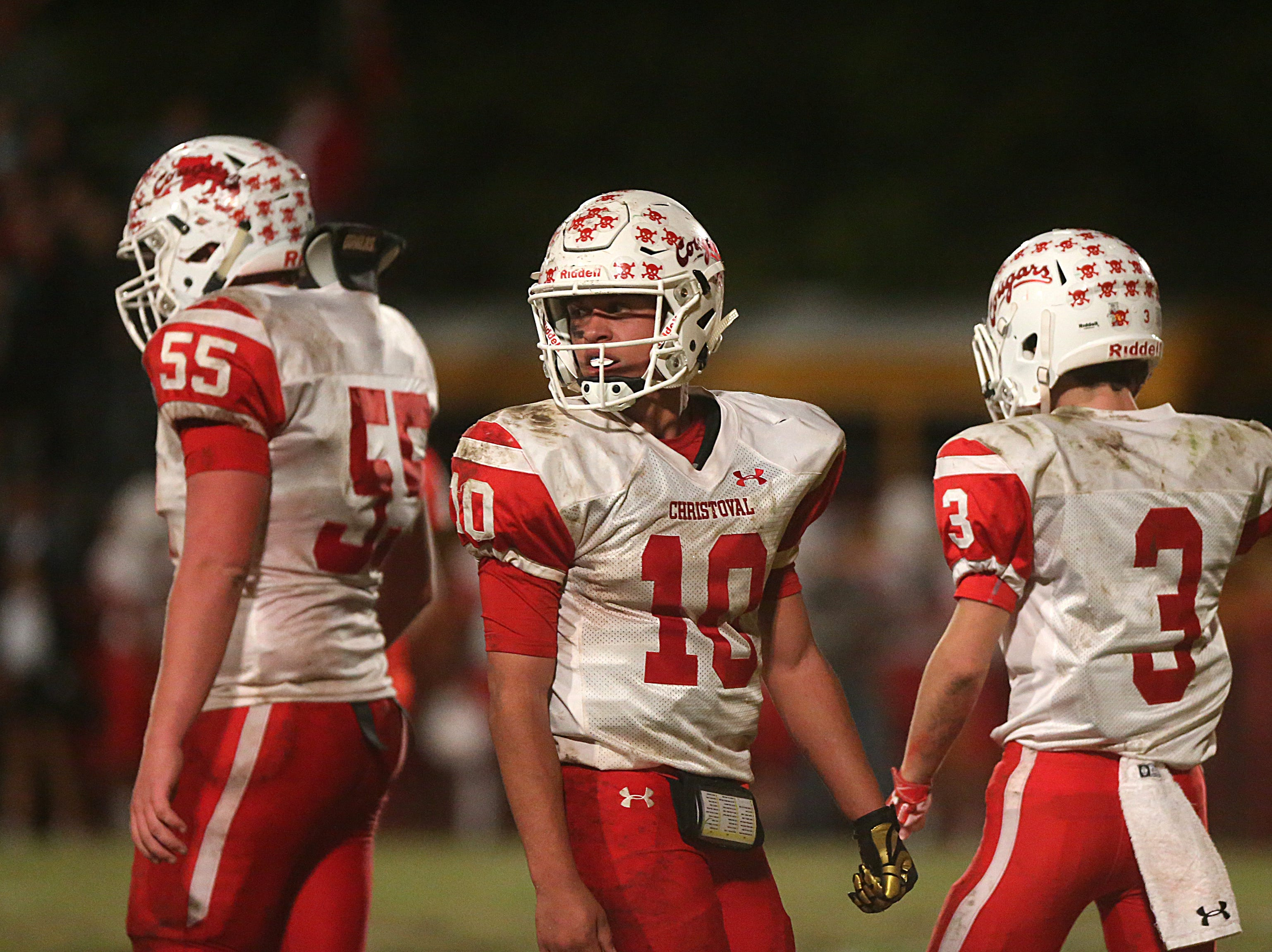 Christoval's Brayden Wilcox (#10), Westen McAllister (#55) and Clayton Edmiston (#3) regroup Friday, Nov. 2, 2018 during their game against Miles.
