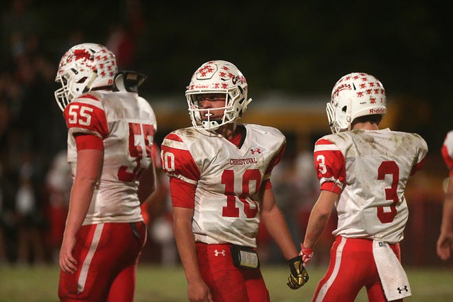 Christoval's Brayden Wilcox (10), Westen McAllister (55) and Clayton Edmiston (3) prepare to huddle Friday, Nov. 2, 2018, during their game against Miles.