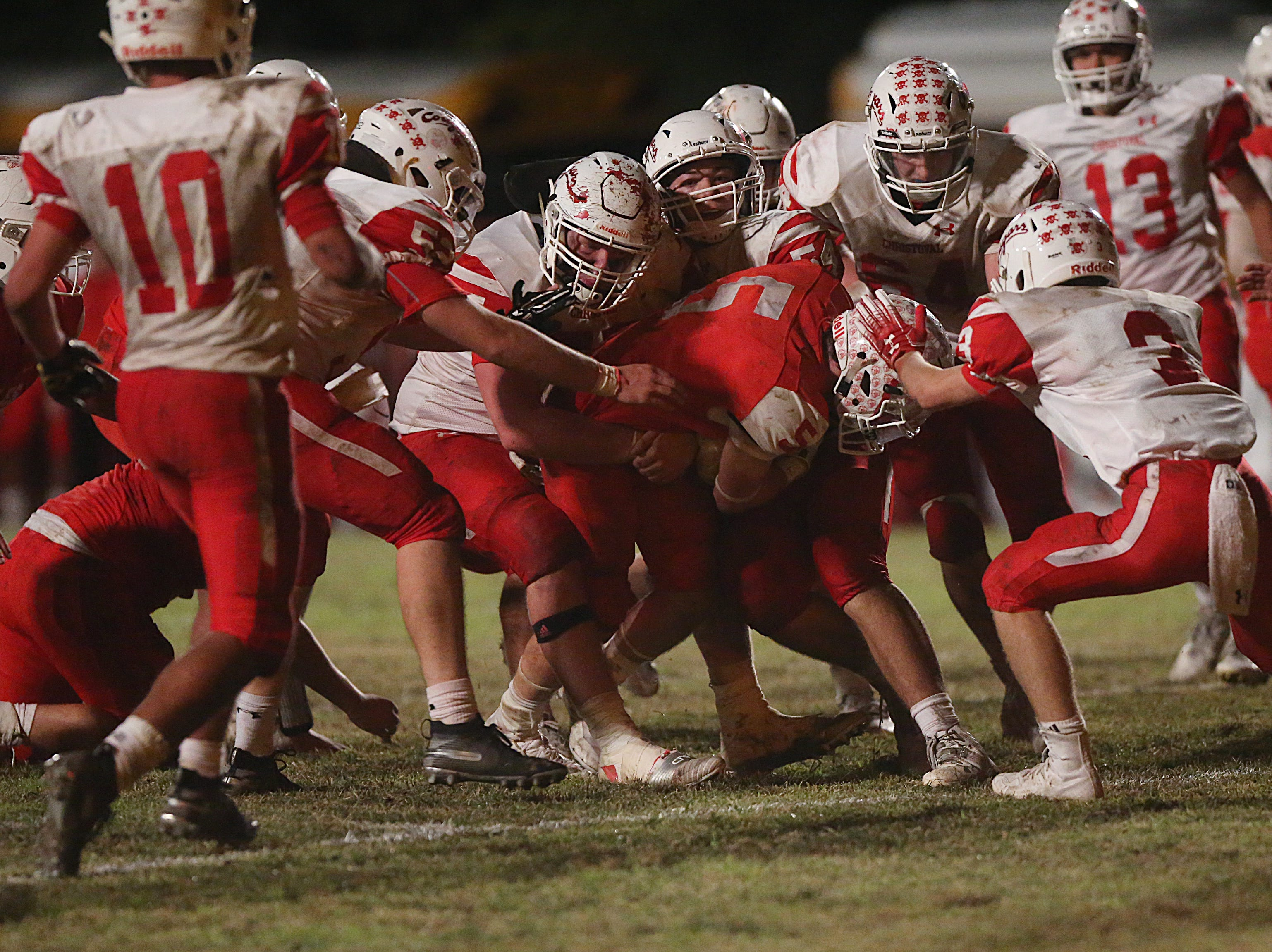 Miles' Mason Bryan (#5) is brought down by several Christoval players just before the end zone Friday, Nov. 2, 2018 during their game in Miles.