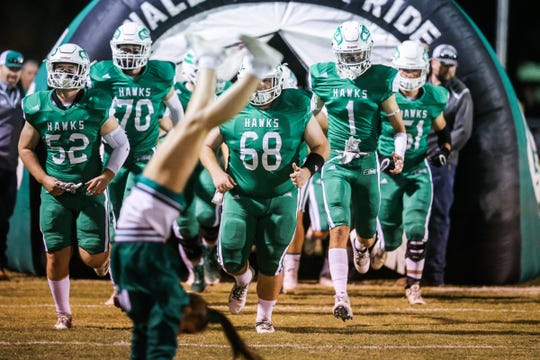Wall football team makes their way out to the field for the game against Breckenridge Friday, Nov. 2, 2018, at Wall.