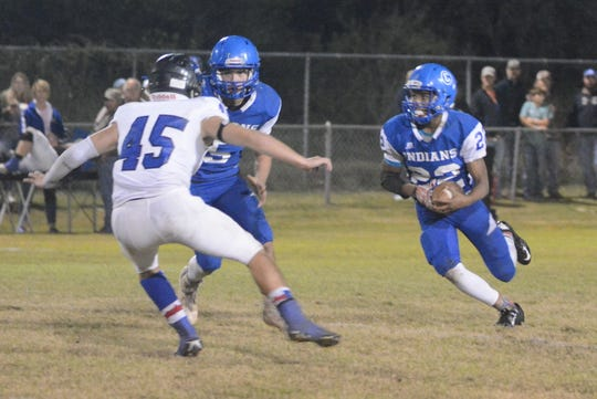 Cherokee's Tristian Arkansas (22) looks for running room as Richland Springs' Cameron Parham (45) tries to make a tackle Friday, Nov. 2, 2018, in Cherokee.