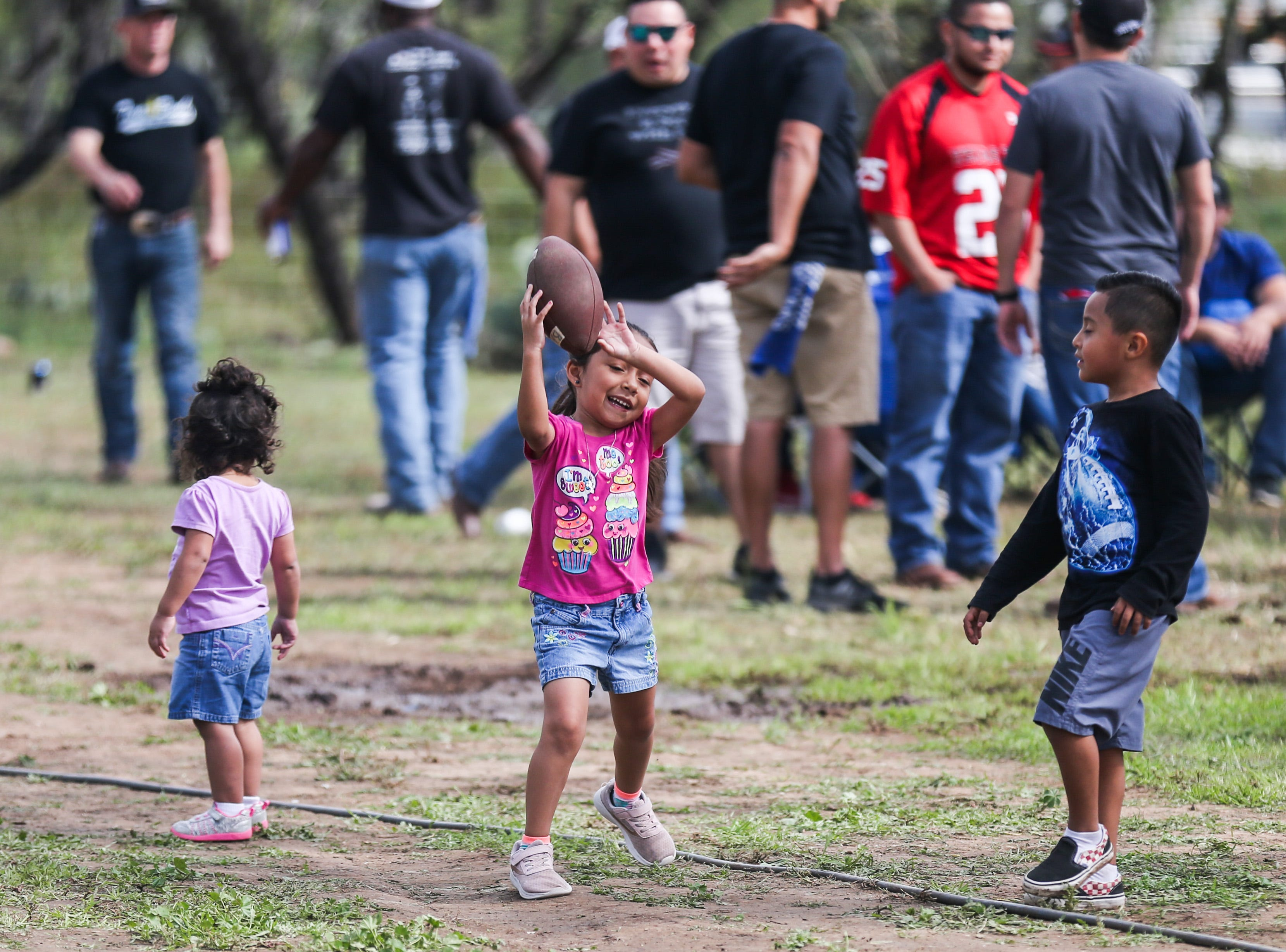 Children play catch during God's County Menudo Cook-off Saturday, Nov. 3, 2018, in north San Angelo.