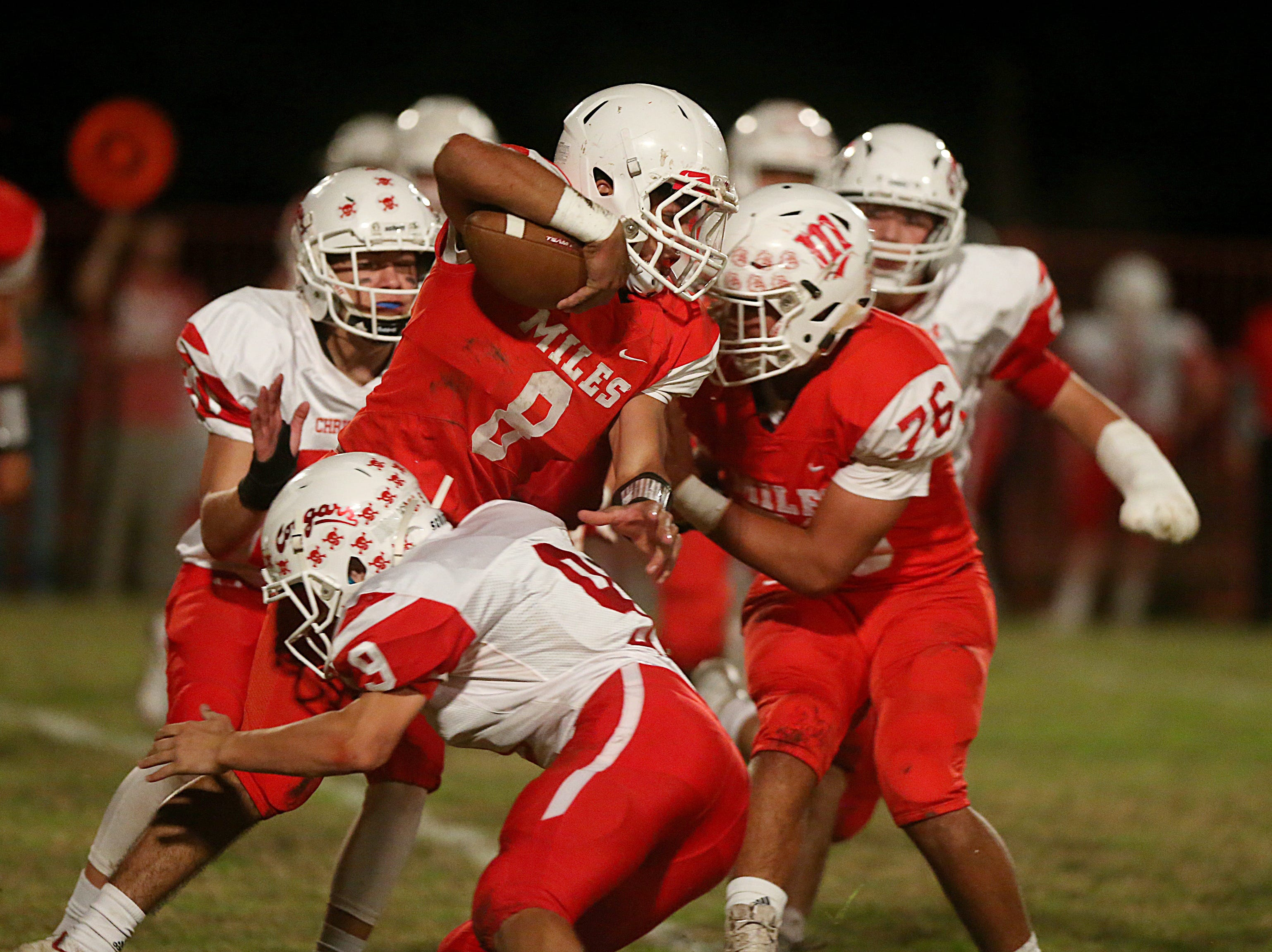 Miles' Jared Flores (#8) is tackled by Christoval's Luke Jolly (#9) Friday, Nov. 2, 2018 during their game in Miles.