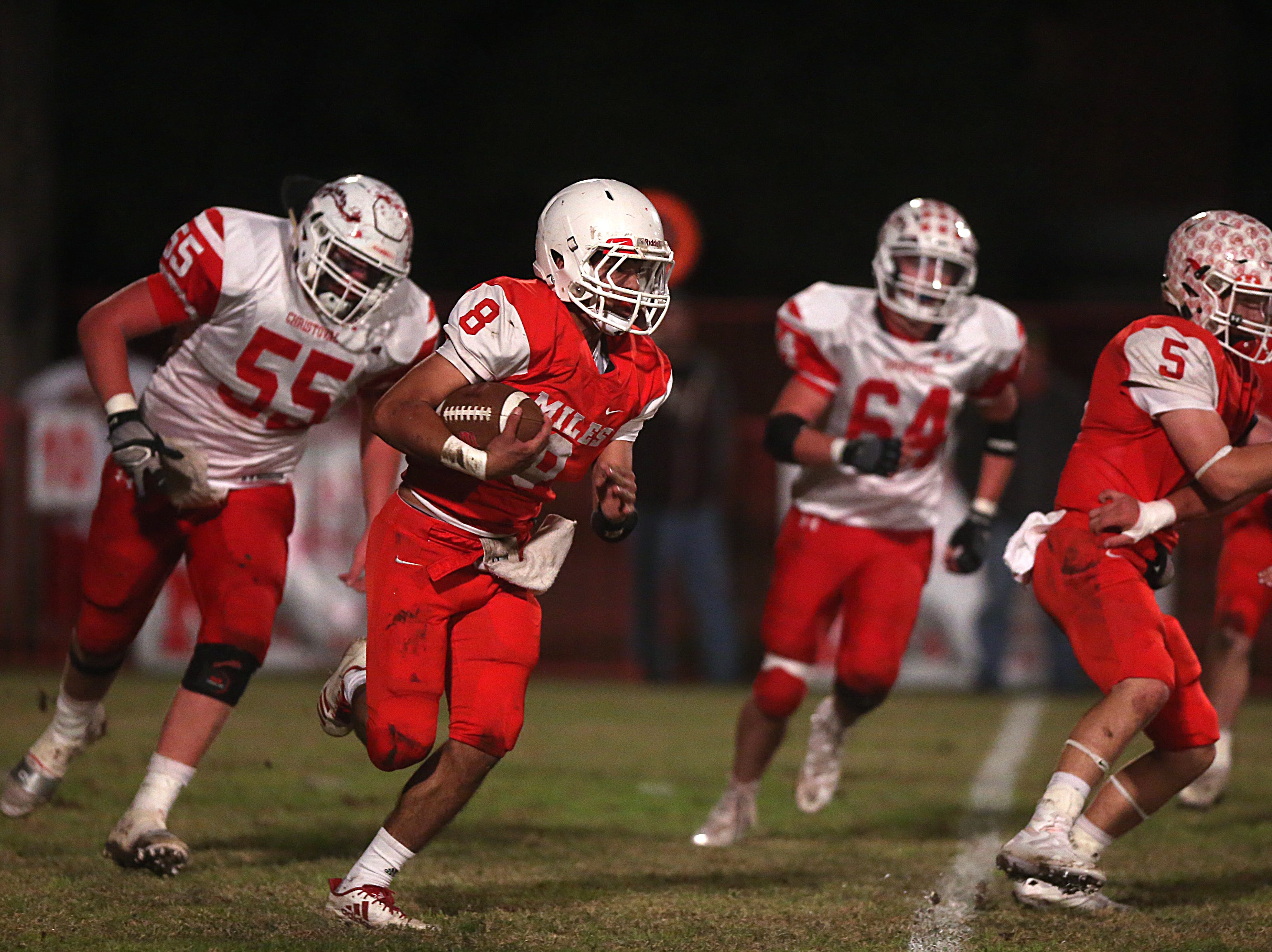 Miles' Jared Flores (#8) rushes past Christoval's defense Friday, Nov. 2, 2018 during their game in Miles.