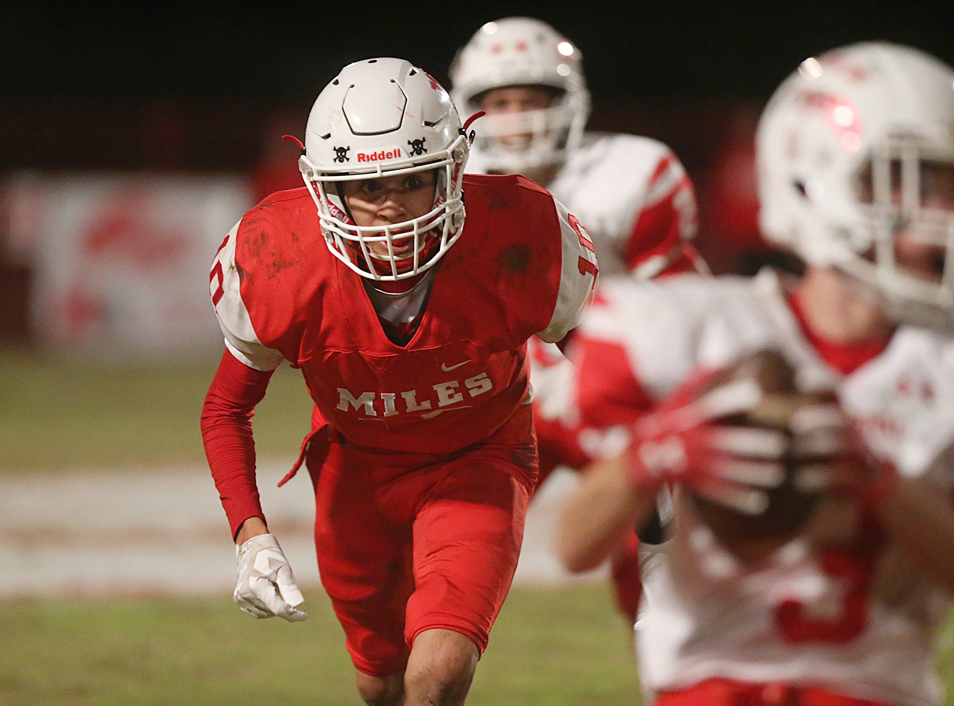 Miles' Noel Sanchez (#10) rushes from behind against  Christoval's Clayton Edmiston (#3) Friday, Nov. 2, 2018 during their game in Miles.