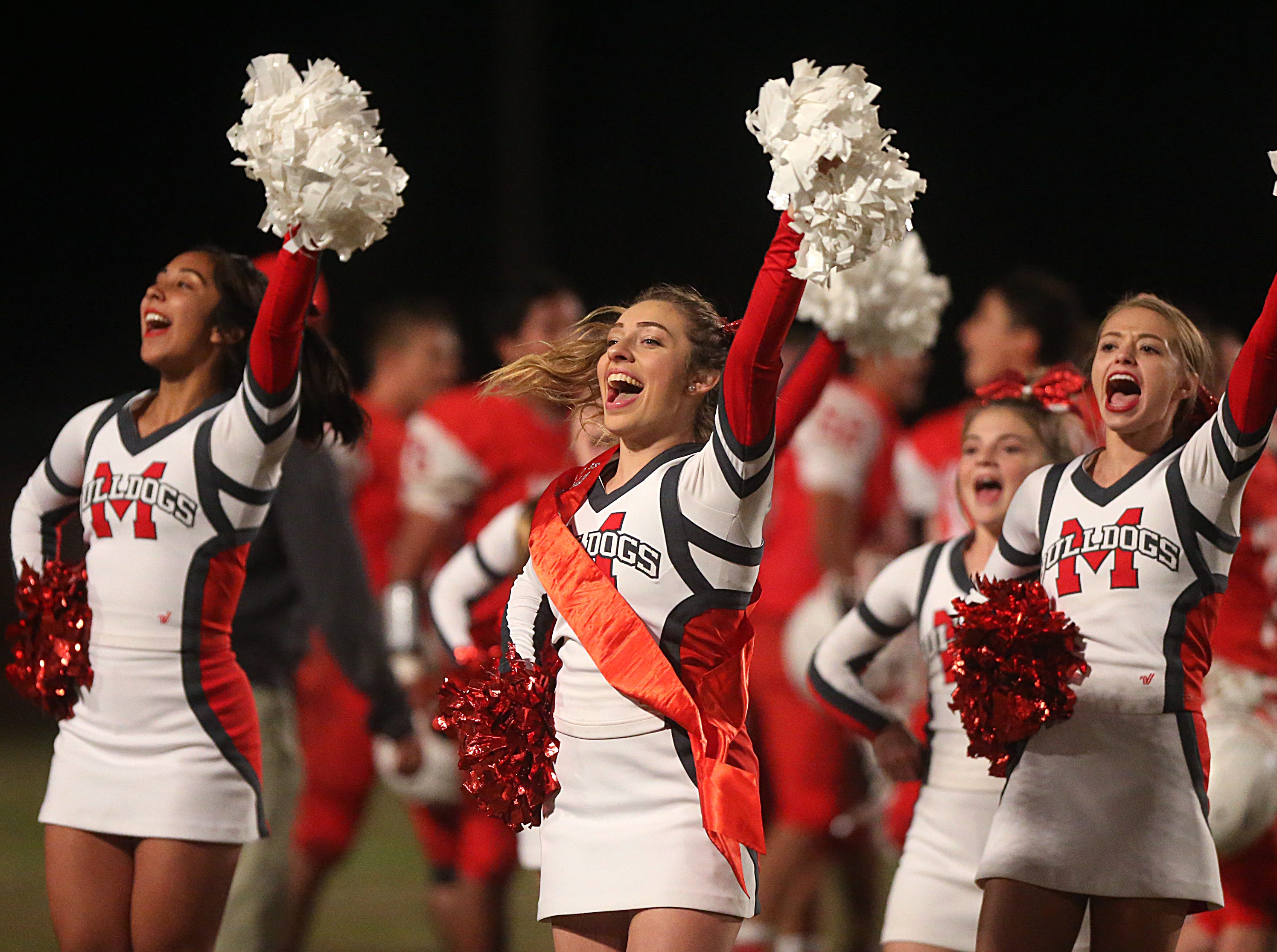 Miles' cheerleaders celebrate Friday, Nov. 2, 2018 after beating Christoval 21 to 20.