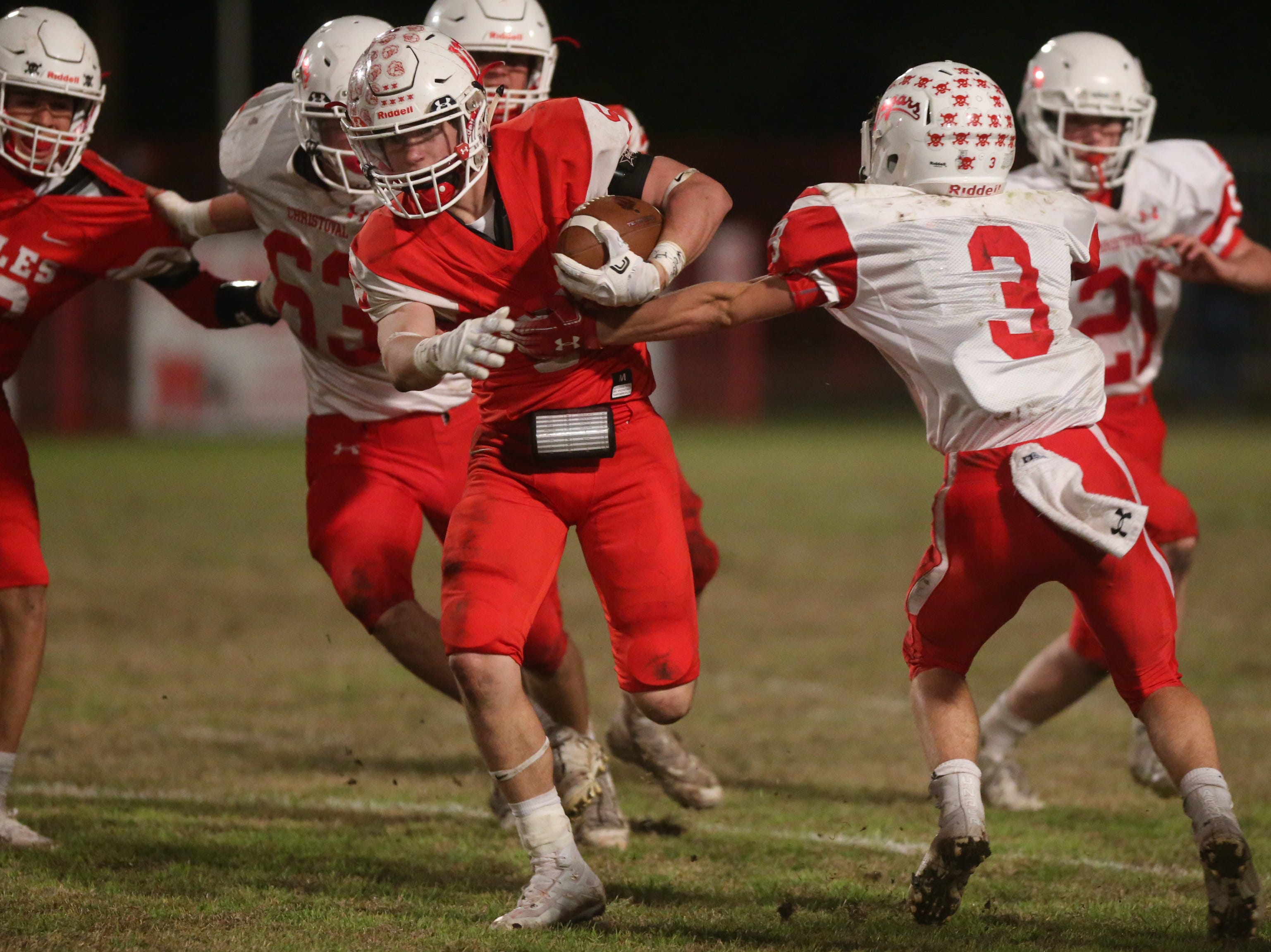 Christoval's Clayton Edmiston (#3) grabs hold of Miles' Mason Bryan (#5) Friday, Nov. 2, 2018 during their game in Miles.