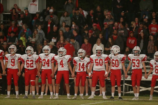 Christoval Cougars watch the coin toss Friday, Nov. 2, 2018 as their game against Miles.