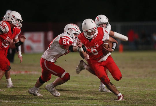 Miles' Jared Flores (#8) is stopped by Christoval's Clay Chappell Friday, Nov. 2, 2018 during their game in Miles.