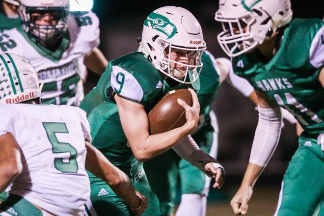 Wall's Mason Fuchs runs the wall against Breckenridge defense Friday, Nov. 2, 2018, at Wall.