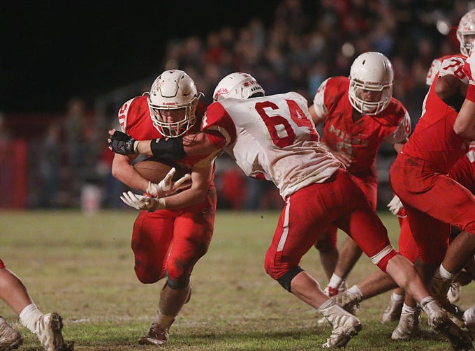 Christoval's Clay Chappell (#64) tackles Miles' Sterling Barker (#20) Friday, Nov. 2, 2018 during their game in Miles.