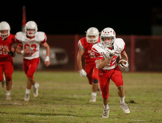 Christoval's Beau Jolly (2) picks up some yards during a game against Miles at Bulldog Stadium in Miles on Friday, Nov. 2, 2018.