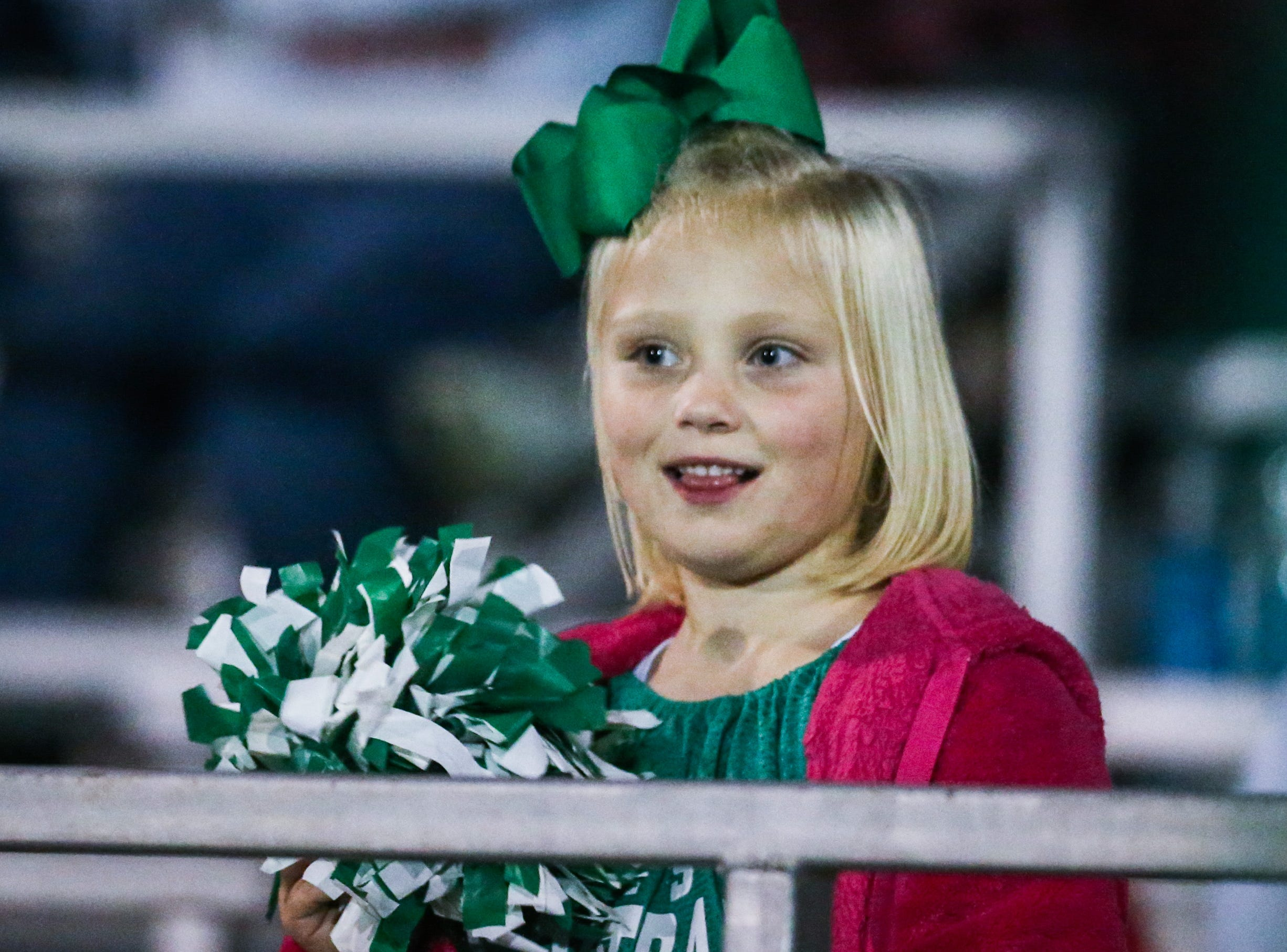 A young fan dances along with Wall cheerleaders during the game against Breckenridge Friday, Nov. 2, 2018, at Wall.