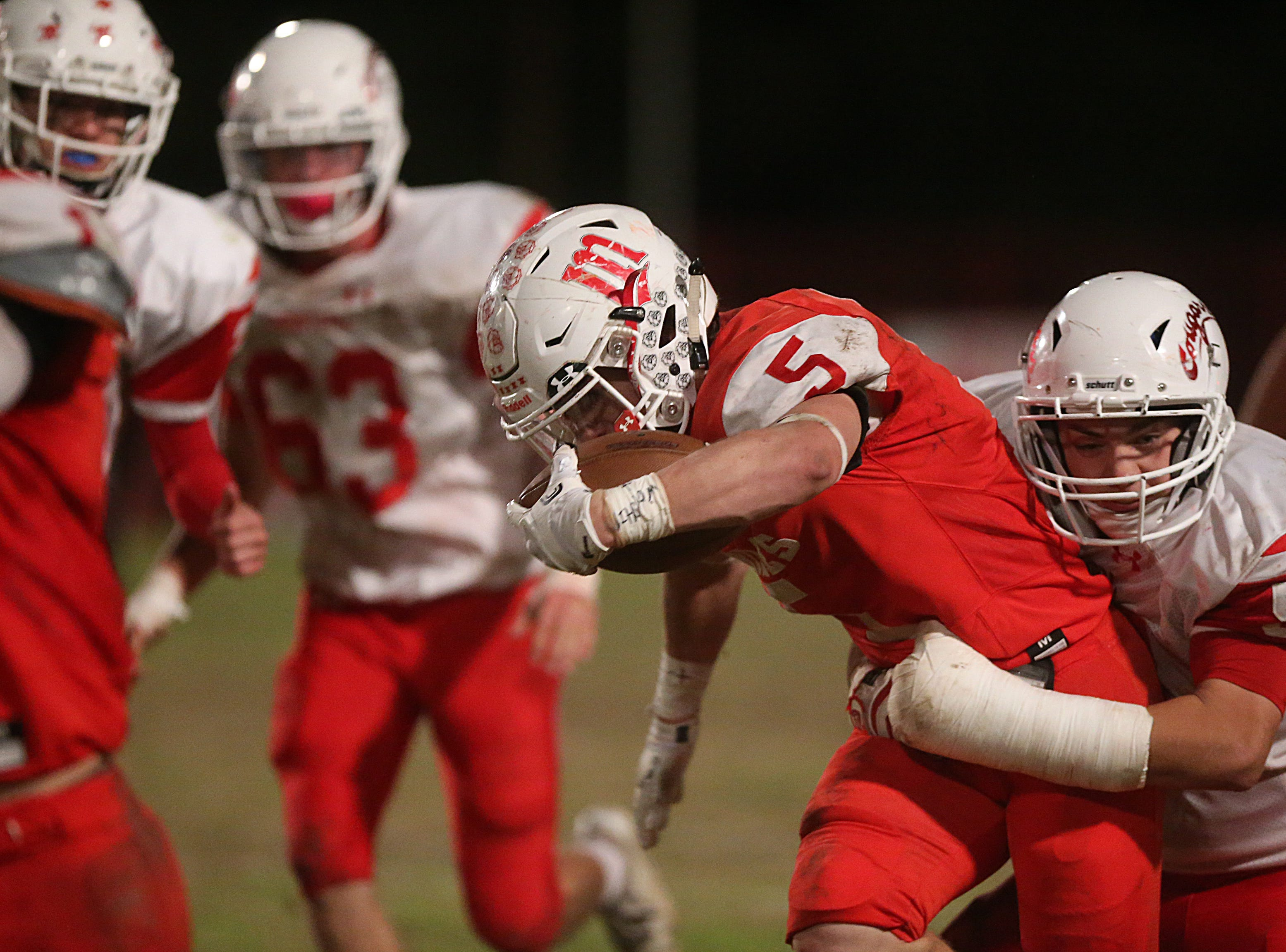 Miles' Mason Bryan (#5) is taken down by Christoval's Colton Clevenger (#54) Friday, Nov. 2, 2018 during their game in Miles.