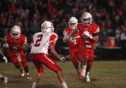 Miles' Mason Bryan (#5) locks eyes with Christoval's Beau Jolly (#2) Friday, Nov. 2, 2018 during their game in Miles.