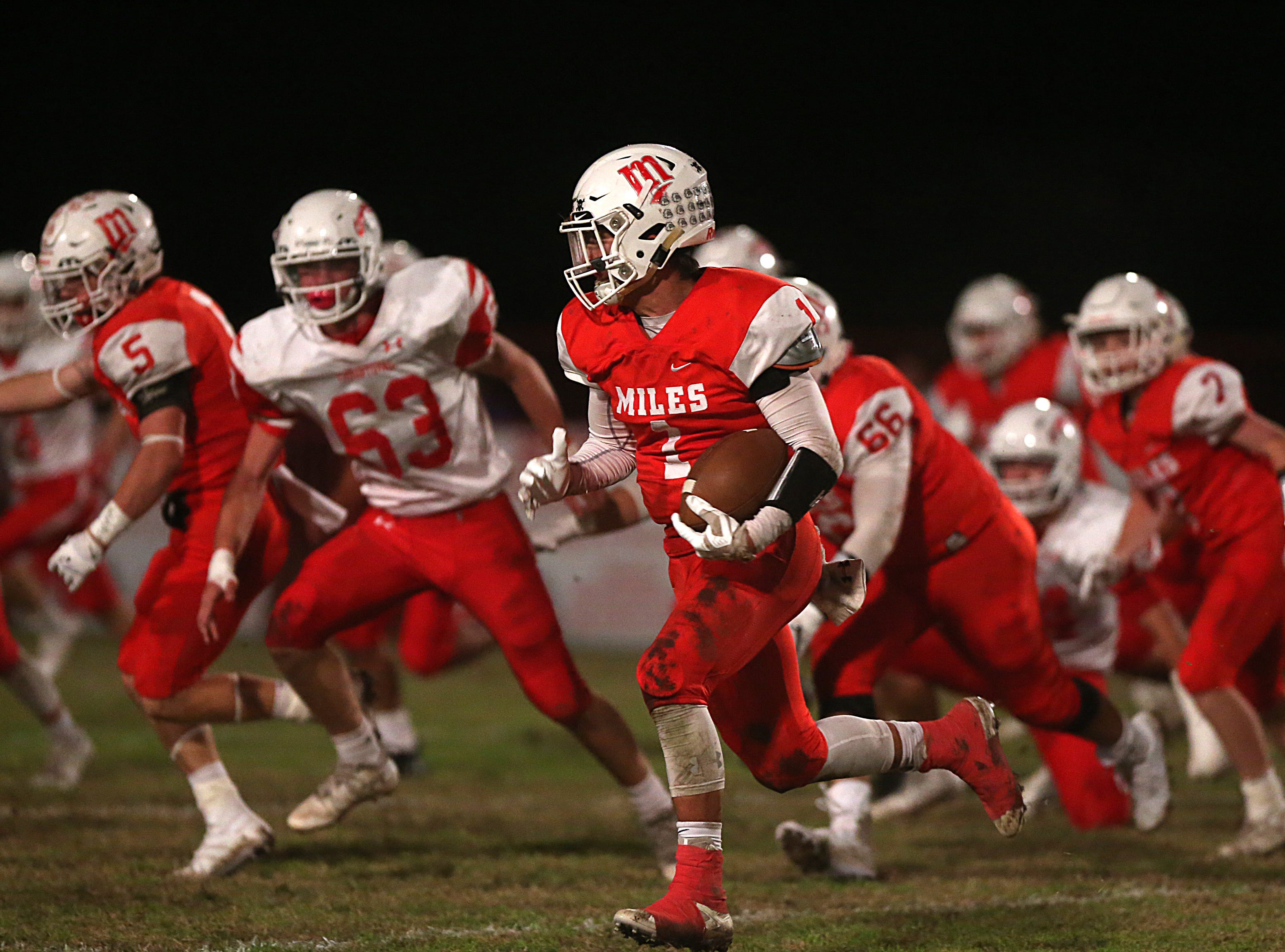 Miles' Davian Martinez (#1) rushes past Christoval's defense Friday, Nov. 2, 2018 during their game in Miles.