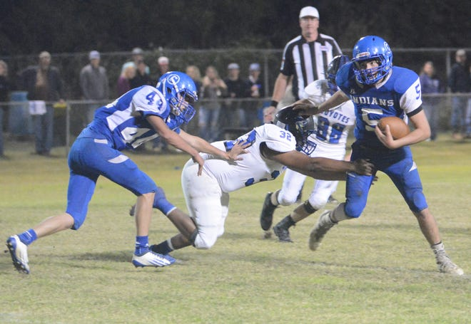 Cherokee's Blaize Lopez tries to break loose from Richland Springs' Agustin Oyervides during their district football game Friday, Nov. 2, 2018, in Cherokee.