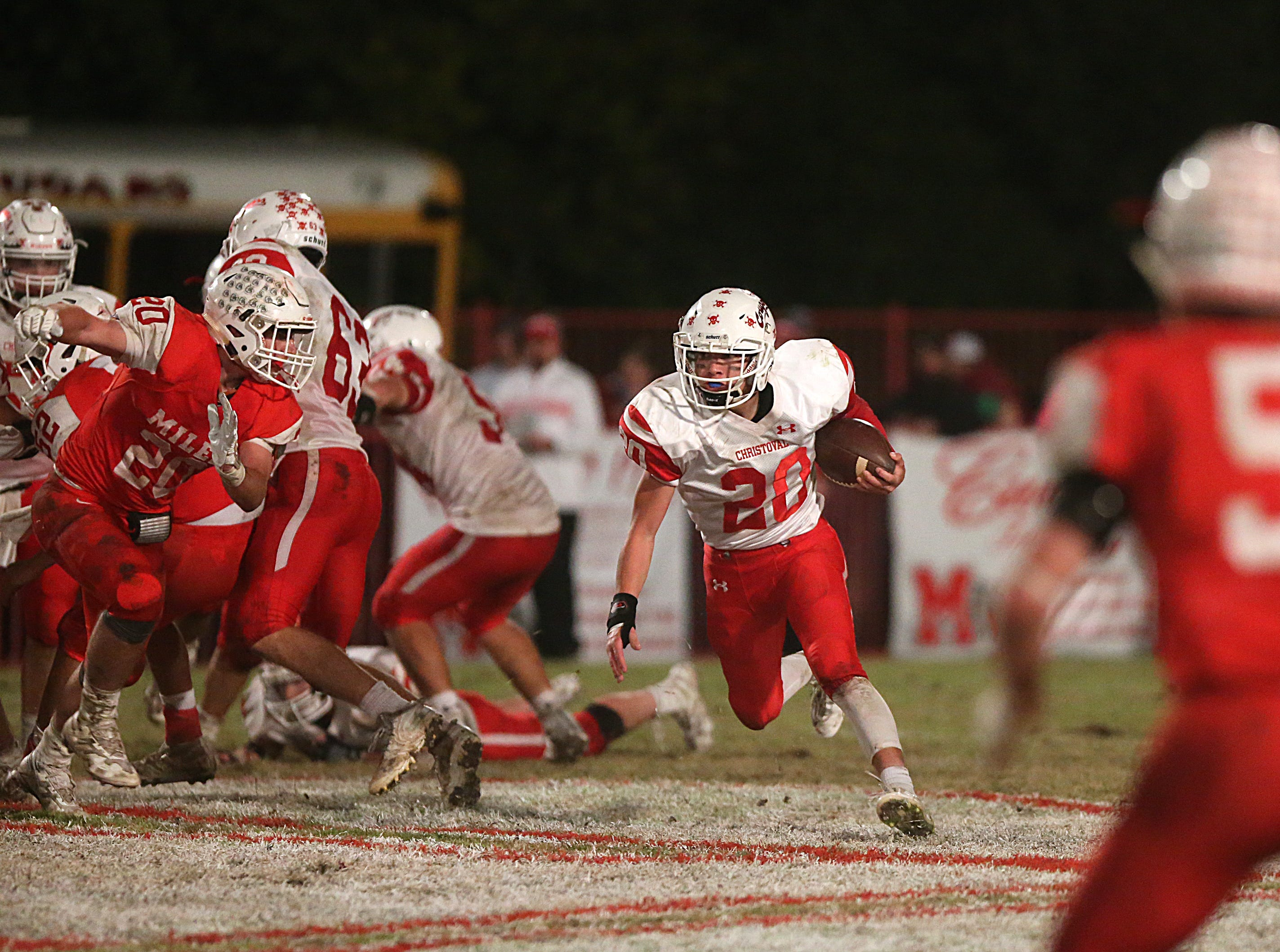 Christoval's Josh Fava (#20) tries to maneuver around Miles' defense Friday, Nov. 2, 2018 during their game in Miles.