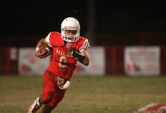 Miles' Jared Flores (#8) makes a play downfield Friday, Nov. 2, 2018 during their game against Christoval.