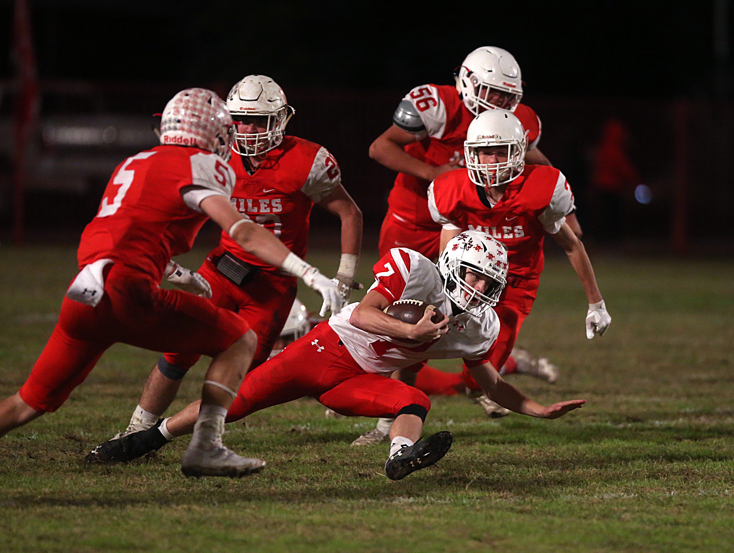 Christoval's David Fava (#7) slides to the ground while trying to outrun Miles' defense Friday, Nov. 2, 2018 during their game in Miles.