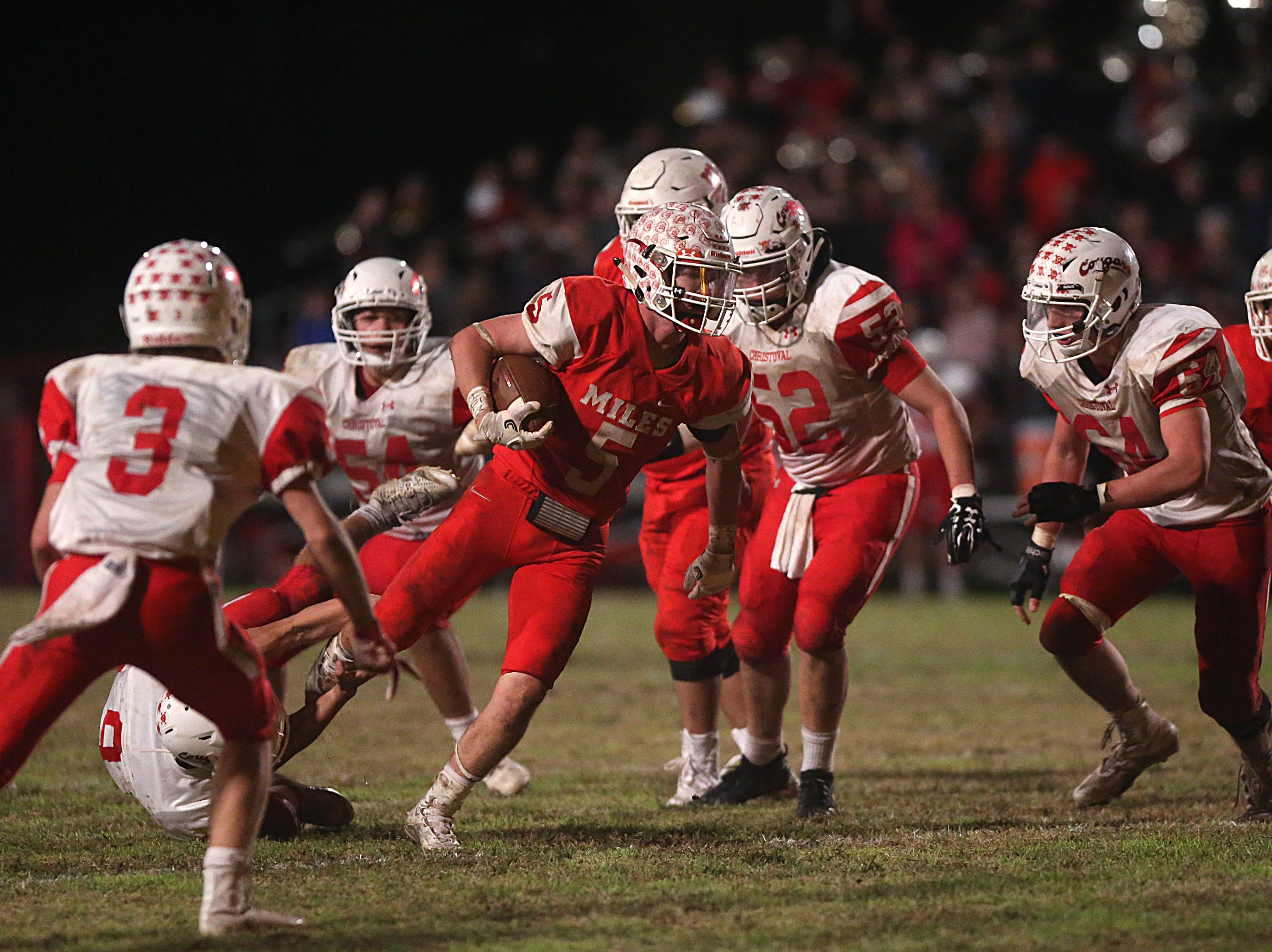 Miles' Mason Bryan (#5) is tripped up by a Christoval player  Friday, Nov. 2, 2018 during their game in Miles.