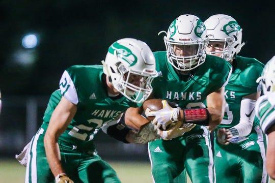 Wall High School's Mason Kindle runs the ball against Breckenridge earlier this season.