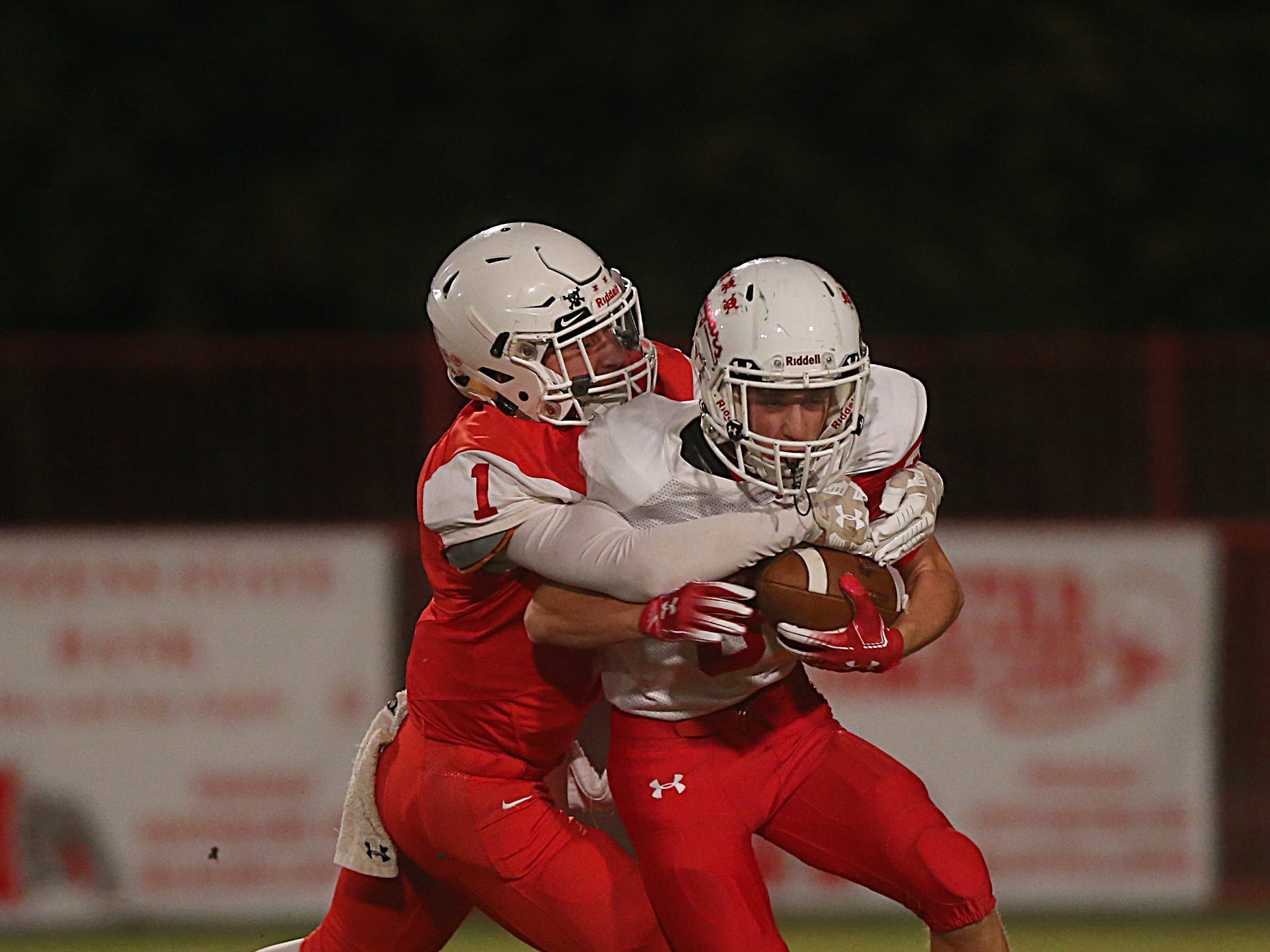 Miles' Davian Martinez (#1) tackles Christoval's Clayton Edmiston (#3) Friday, Nov. 2, 2018 during their game in Miles.