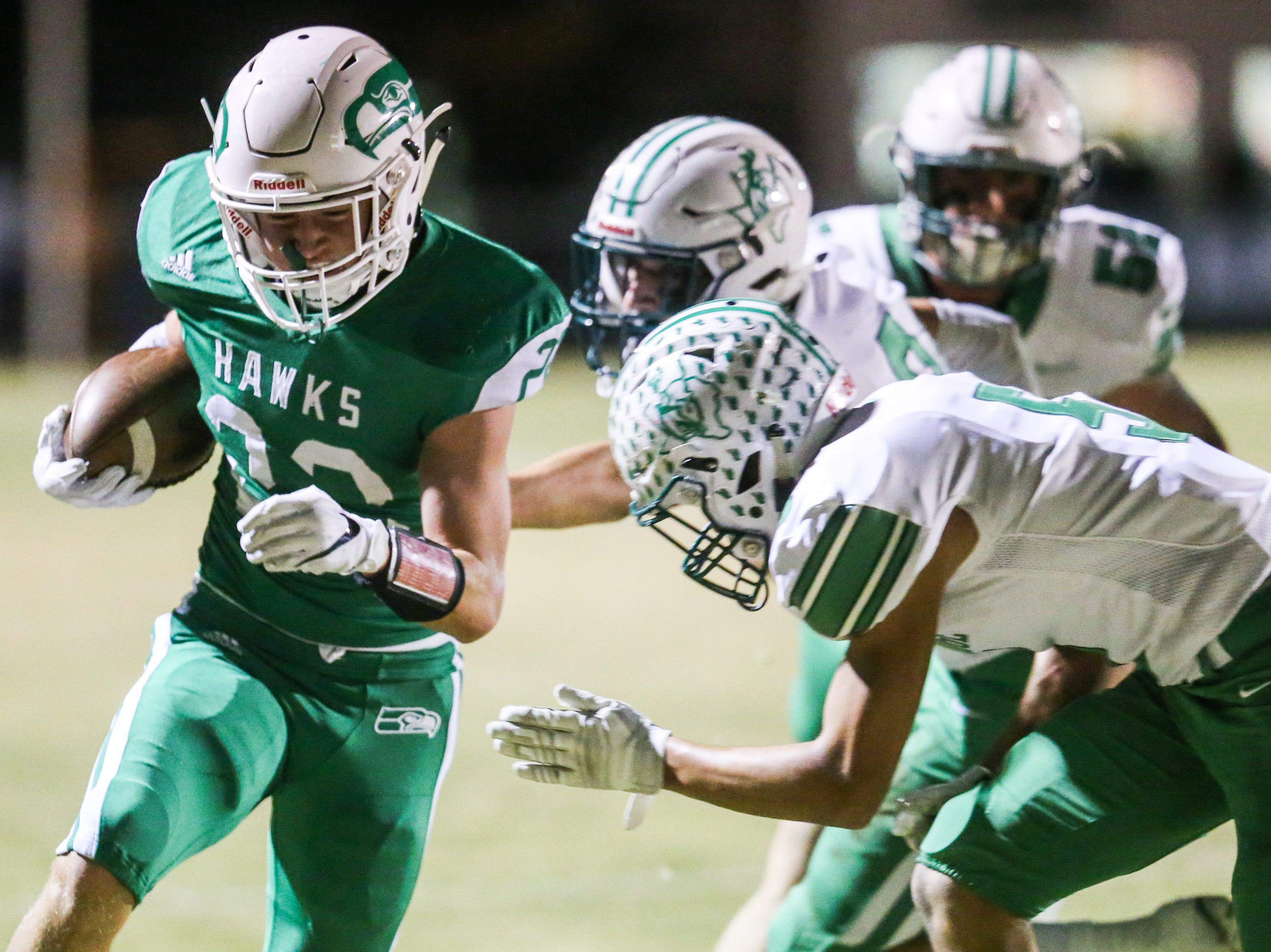 Wall's Mason Kindle runs the ball as Breckenridge defense approaches Friday, Nov. 2, 2018, at Wall.