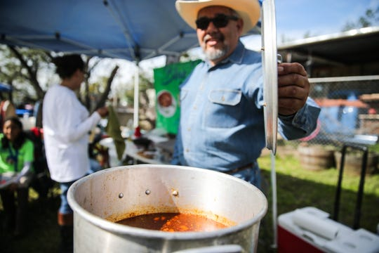 Joe Peres watches over his team's menudo during God's County Menudo Cook-off Saturday, Nov. 3, 2018, in north San Angelo.