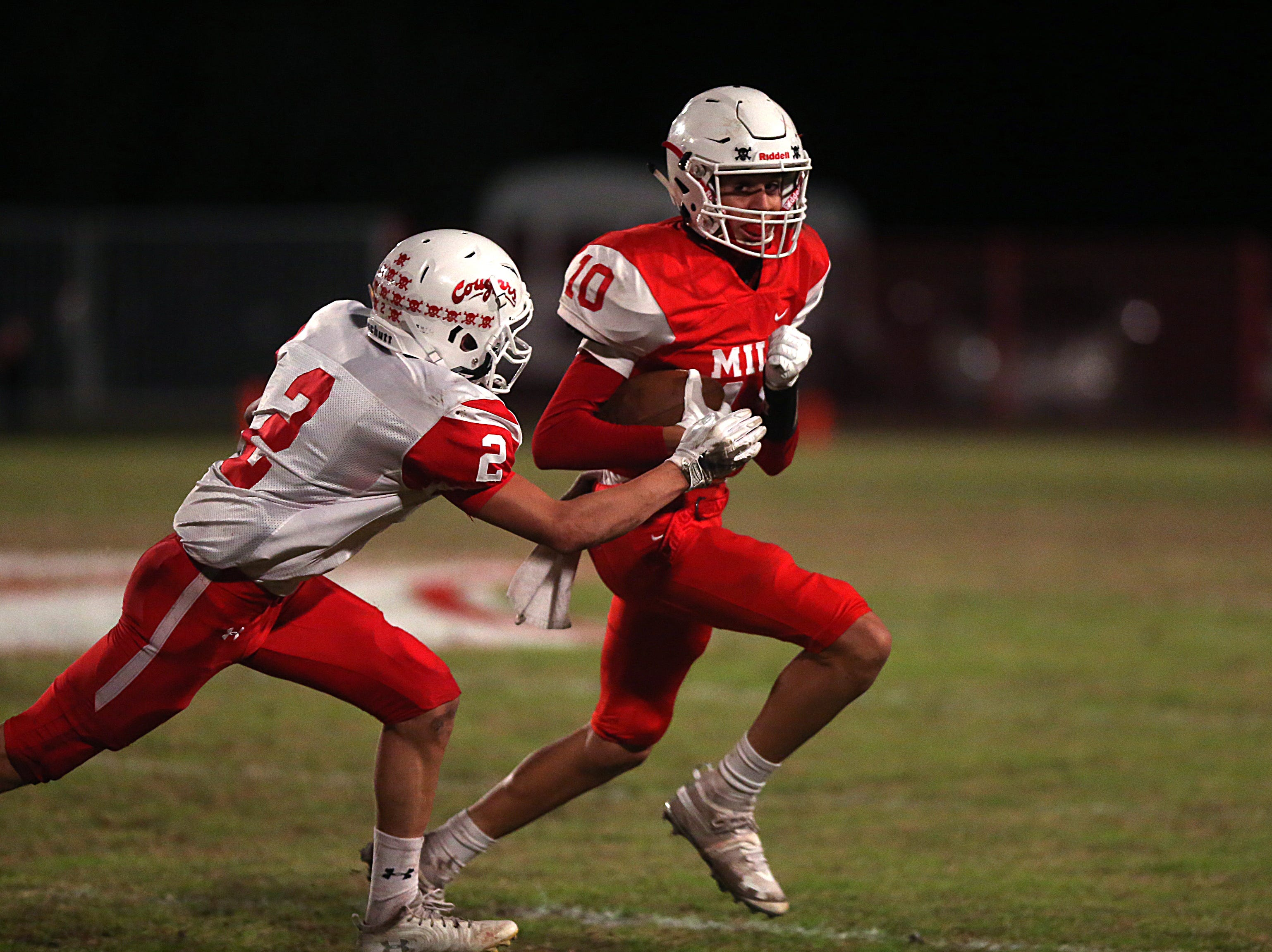 Miles' Noel Sanchez (#10) tries to escape from Christoval's Beau Jolly (#2) Friday, Nov. 2, 2018 during their game in Miles.